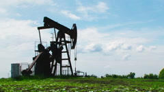 Oil Pump Digging While Producing Natural Gas Stock Footage