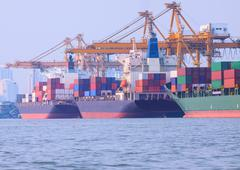 Commercial ship loading container in shipping port image use for import ,expo Stock Photos
