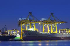 Beautiful lighting of container ship in port  use for import,export and freig Stock Photos