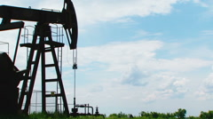 Metal Oil Pump Moving While Producing Natural Gas - stock footage