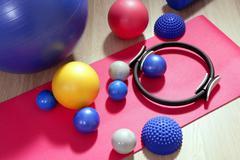 Stock Photo of balls pilates toning stability ring roller yoga mat