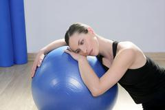 aerobics fitness woman relax pilates stability blue bal - stock photo