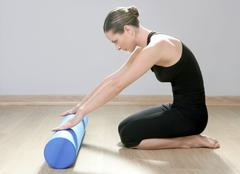blue foam roller pilates woman sport gym fitness yoga - stock photo