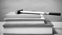 Book with hammer black and white color tone style Stock Photos