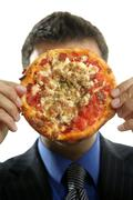Businessman and junk fast food, pizza Stock Photos