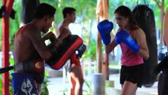 Girl Muay Thai Boxing Training Pad Work Kicking Punching Combat Sport Hand Held - stock footage