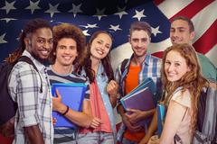 Stock Photo of Composite image of smiling group of students holding folders