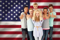 Stock Photo of Composite image of group of teenagers standing in front of the camera with