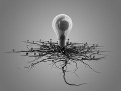 Stock Illustration of Light bulb with roots and emerged on the icon with roots.
