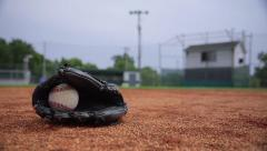Infield Baseball and Glove Stock Footage