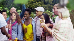 4K Happy group of friends having fun at outdoor bbq. Stock Footage