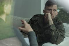 Despair soldier receiving psychological advice Stock Photos