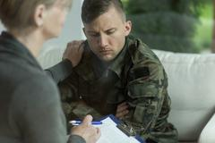 Psychiatrist and despair military man - stock photo