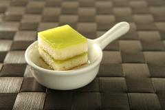 Pastries over spoon - stock photo
