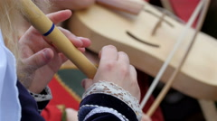 A man in blue coat playing the flute Stock Footage