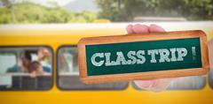 Class trip! against cute pupils smiling at camera in the school bus Stock Photos