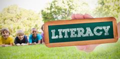 Literacy against happy friends in the park - stock photo