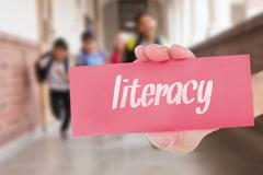 Literacy against teacher helping pupils in library Stock Photos