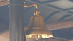 Golden small bell hanging on the roof Stock Footage