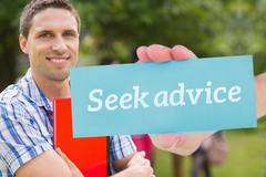 Seek advice against happy student smiling at camera outside on campus Stock Photos