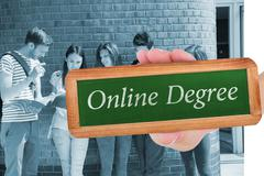 Stock Photo of Online degree against happy students standing and reading