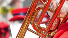 A big tuba being held in a bands play Stock Footage