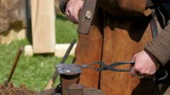 A blacksmith pounding some metal Stock Footage
