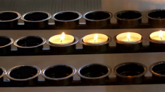Five candles aligned with the holder - stock footage