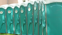 Lots of public toilets on the side of the road Stock Footage