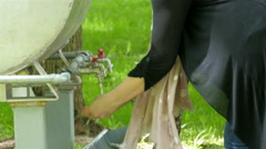 A girl washing her hands on the faucet Stock Footage