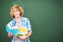 Composite image of student reading book - stock photo