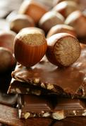 Hazelnuts and chocolate in brown enviroment - stock photo