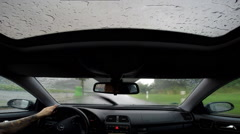 Dash cam driving by very hard rain enter german highway Stock Footage