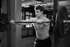 Black And White Shot Of Man Preparing To Lift Weights - stock photo