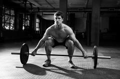 Black And White Shot Of Man Preparing To Lift Weights Stock Photos