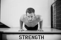 Black And White Shot Of Man In Gym Doing Press-Ups Stock Photos