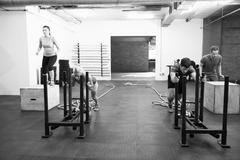 Black And White Shot Of People In Gym Circuit Training Stock Photos