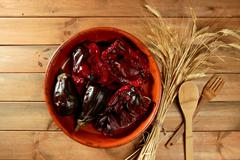Eggplant and peppers roasted & wheat ear spike - stock photo
