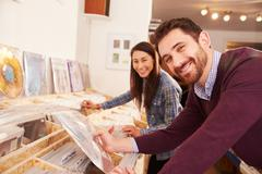 Two people browsing records at a record shop, portrait Stock Photos