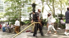 Entrance of Bryant Park with a man holding an Accept Jesus sign. Stock Footage