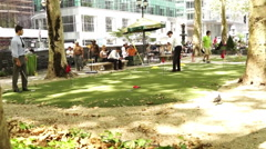 Business men on a putting green in Bryant Park Stock Footage