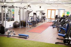 Interior of a gym with fitness equipment Stock Photos
