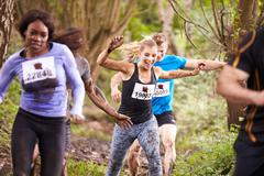 Competitors enjoying a run in a forest at an endurance event - stock photo