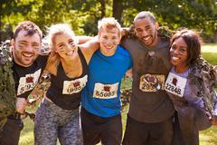 Competitors celebrate completing an extreme endurance event - stock photo