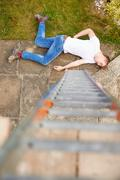 Construction Worker Suffering Injury After Fall From Ladder Stock Photos