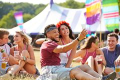 Friends taking selfie at a music festival Stock Photos