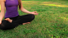 Young girl doing yoga in the park Stock Footage