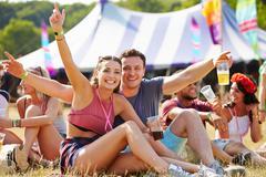Couple having fun at music festival Stock Photos