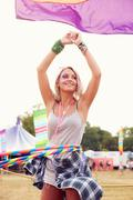 Blonde woman dancing with hula hoop at a music festival, vertical Stock Photos