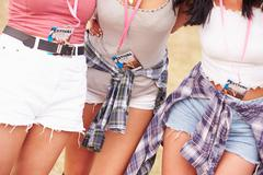 Girl friends at a music festival, crop Stock Photos